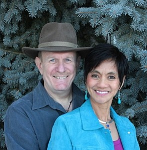 ron and liz pic backyard blue spruce cropped 296x301
